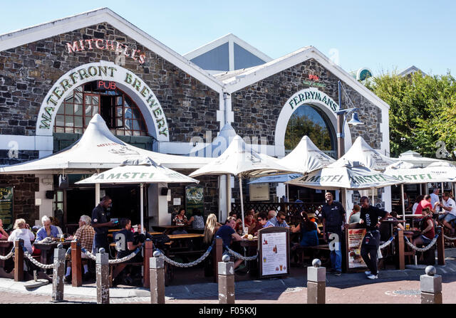Cape Town South Africa African V & A Victoria Alfred Waterfront restaurant alfresco Mitchell's Waterfront - Stock Image