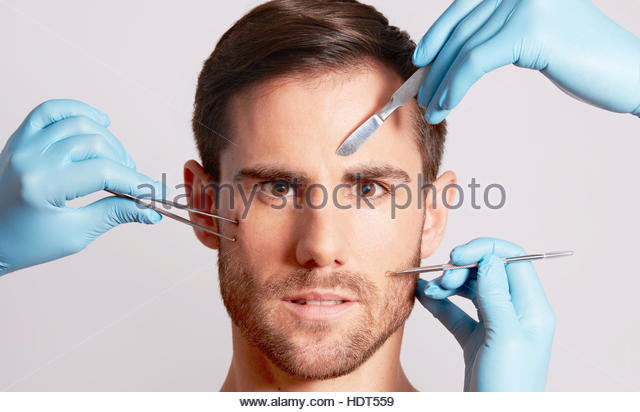 Portrait of mid adult man receiving plastic surgery. - Stock Image
