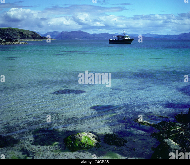 Looking across the Sound of Sleat to Knoydart on mainland Scotland - Stock Image