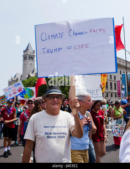 Climate change activist holding holding sign in protest - USA - Stock Image