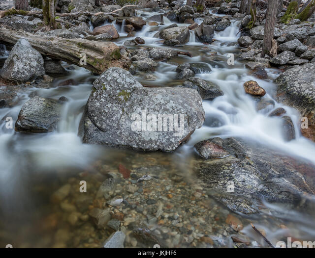 Water Flowing in River Underneath Bridleveil Falls in Yosemite - Stock Image