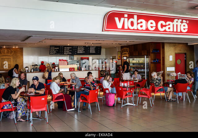 Johannesburg South Africa African O. R. Tambo International Airport inside terminal concourse gate area Vida e Caffe - Stock Image