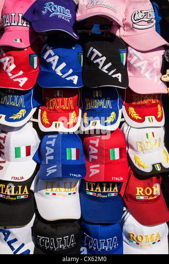 A selection of Rome and Italy baseball caps for sale. - Stock Image