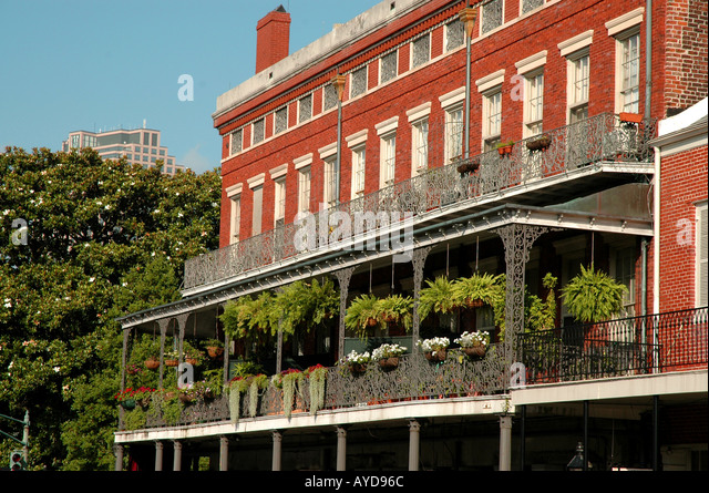 New Orleans LA Louisiana French Quarter building with iron balcony - Stock Image