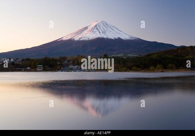Japan Honshu Fuji Hakone Izu National Park Mount Fuji 3776m snow capped and viewed across lake Shoji ko in the Fuji - Stock Image