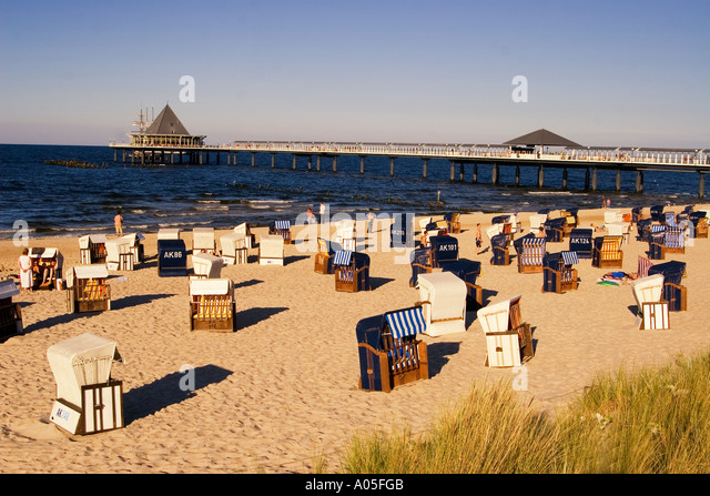 Usedom Heringsdorf beach chairs wind shelter background jetty - Stock Image