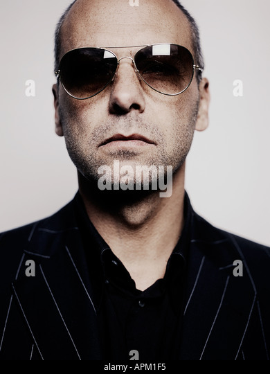 Gangster wearing sunglasses - Stock Image