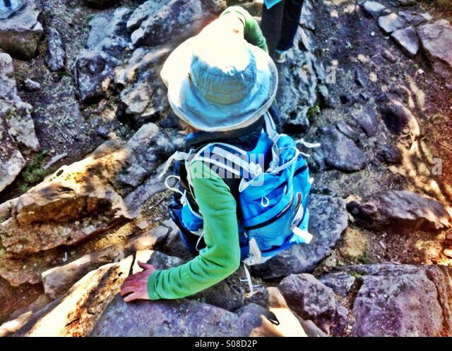 Woman on rocky hiking trail - Stock-Bilder