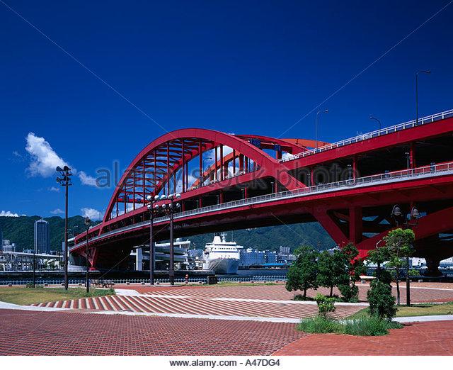 Port Island Kobe Ohashi Kobe Hyogo Japan Sky Clouds Bridge Rows of houses Ship Tree - Stock Image