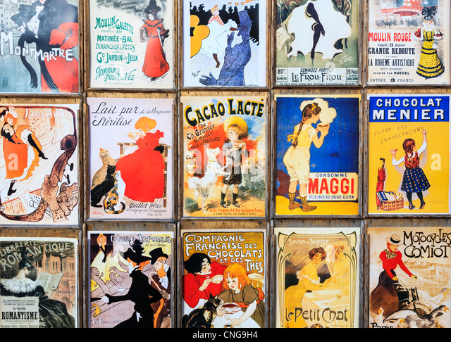 Display of old French advertising posters, Paris - Stock Image