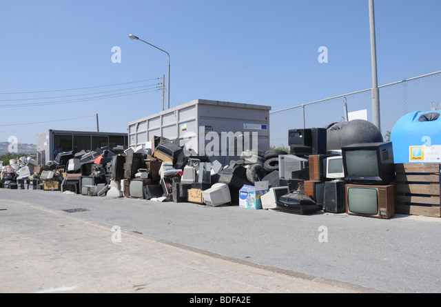 A section in a civic amenity site where used tyres and electrical appliances are disposed for recycling. - Stock Image