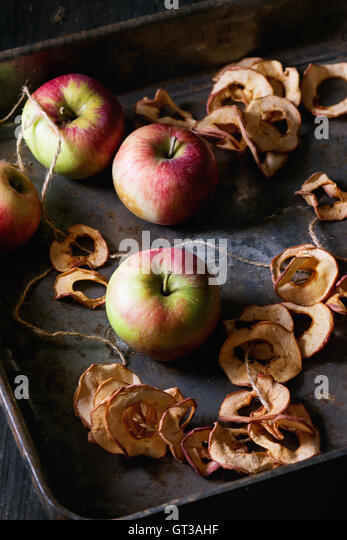 Fresh and dried apples - Stock Image