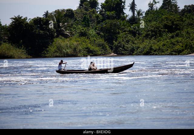 boat river rapids Cameroon Kribi rain forest row - Stock-Bilder