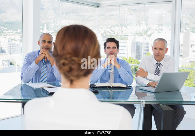 Businesswoman at work interview - Stock Image