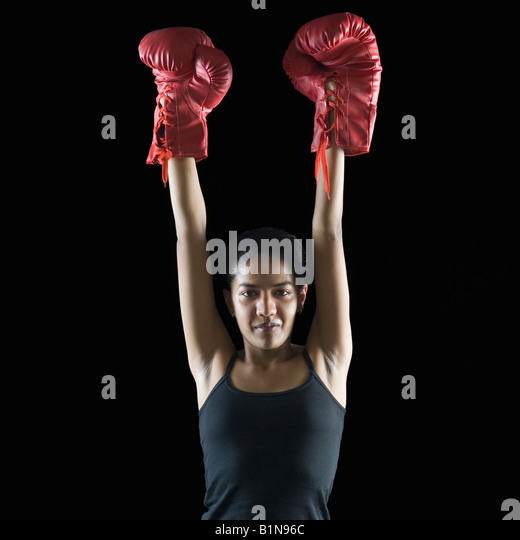 Portrait of a female boxer in boxing stance - Stock Image