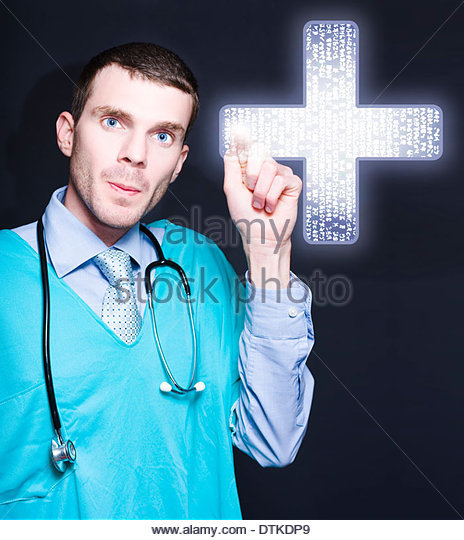 New Age Doctor Of Medicine Using Finger To Press A Large Futuristic Medical Cross Interface When Filing Away Electronic - Stock Image