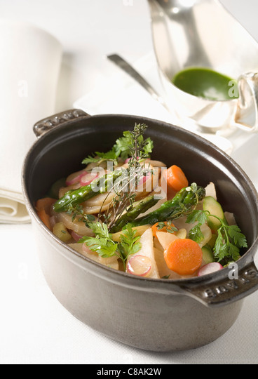 Casserole dish of vegetables with herbs - Stock Image