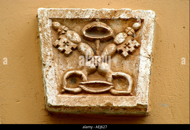 Papal Keys motif on a house in Le Marche Italy - Stock Image