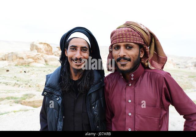Young Bedouin men wearing a traditional eyeliner called Kohel. - Stock Image