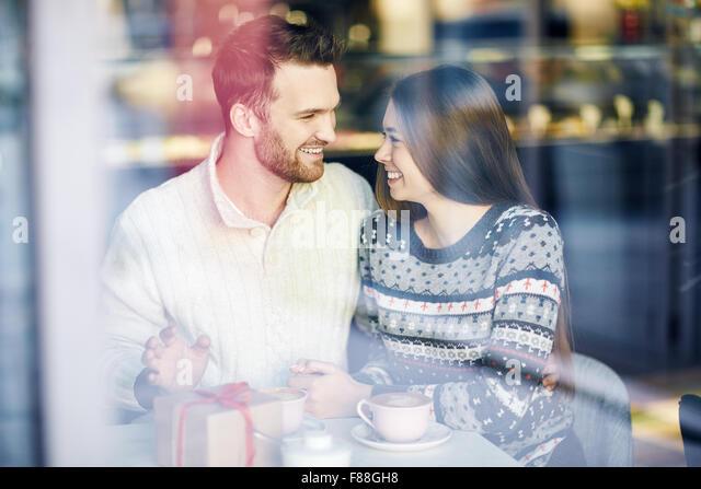 Romantic dates enjoying time in cafe - Stock-Bilder