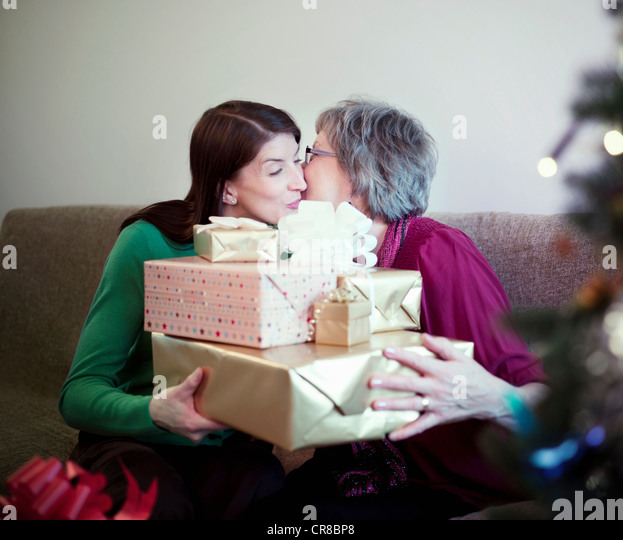 Mother and daughter with birthday presents - Stock-Bilder