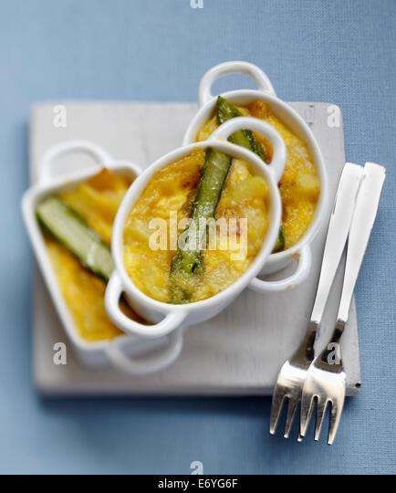 Potato and green asparagus Fritata casseroles - Stock Image
