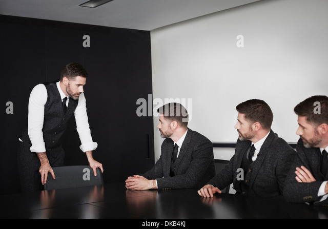 Businessmen in meeting, multiple image - Stock-Bilder