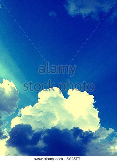 Blue Sky Fluffy Clouds - A Perfect Day - Stock Image