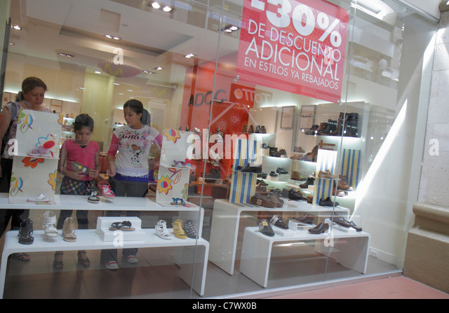 Managua Nicaragua Metrocentro shopping center mall business ADOC retail chain shoe store footwear display women's - Stock Image