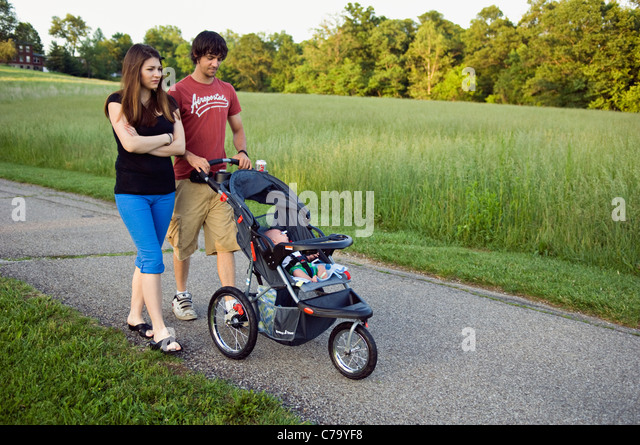 Young Couple Strolling their New Baby in Floyd County, Indiana - Stock-Bilder