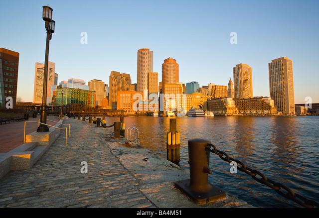 Boston Harbor skyline and waterfront at sunrise, financial district - Stock Image
