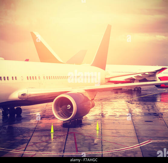 Vintage filtered picture of an airport, transportation and travel concept. - Stock Image