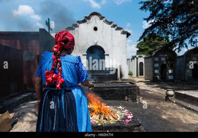 Chichicastenango, Guatemala - April 24, 2014: Maya woman performing a traditional mayan ritual in Chichicastenango - Stock Image