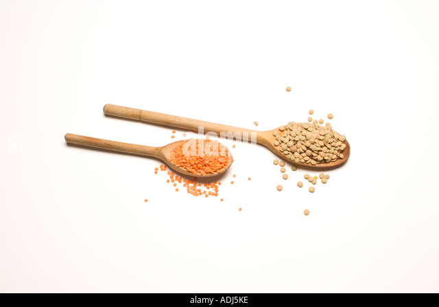 Lentils on wooden spoons - Stock Image