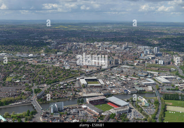 An aerial view looking from Trent Bridge, Nottingham. Both football grounds and the cricket ground visible, city - Stock Image