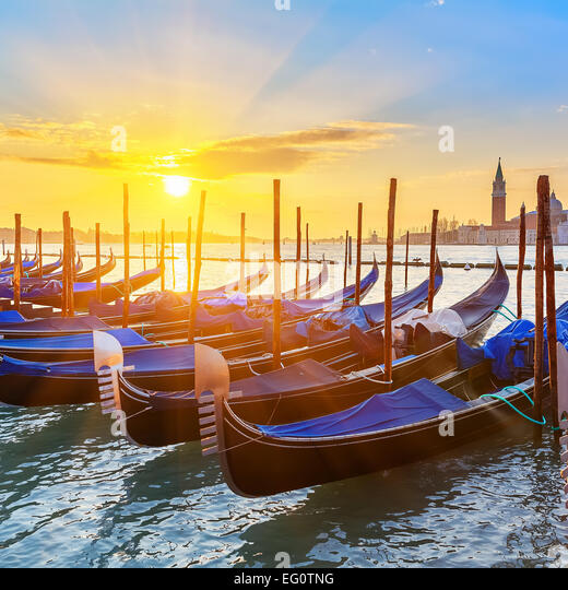 Venetian gondolas at sunrise - Stock Image