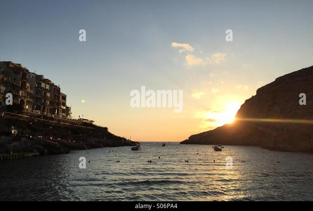 Sunset at Xlendi Bay in Gozo - Stock Image