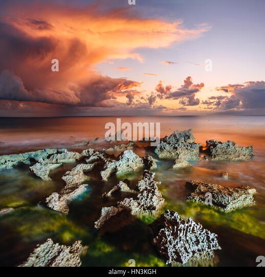 sunset at coast of the sea - Stock Image