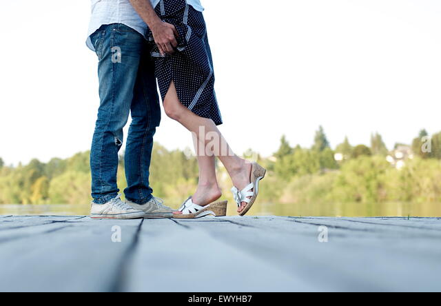 Low section of a couple kissing - Stock Image