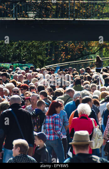 crowd of people at a fair - Stock Image