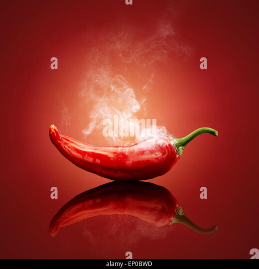 Smoking hot red chilli with reflection - Stock Image