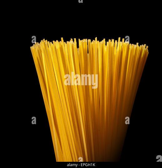 italian spaghetti isolated on black - Stock Image
