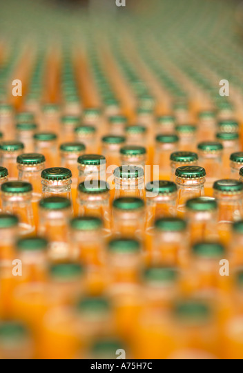 Bottles of soft dring on a production line - Stock Image