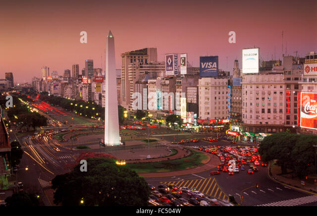 Avenida 9 de Julio at dusk in Buenos Aires with Obelisk and traffic - Stock Image