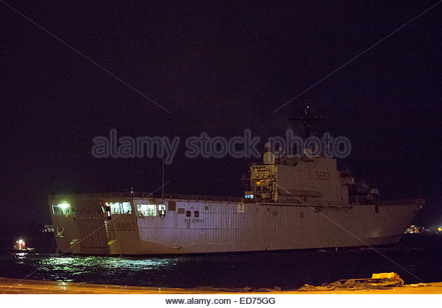 Italy. 30th Dec, 2014. The Italian Navy San Giorgio with rescued passengers of the Norman Atlantic ferry, arrives - Stock Image