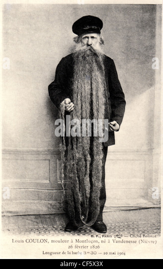 Archival photograph of Louis Coulon and his 11 foot long beard, circa 1904, Paris, France. - Stock Image