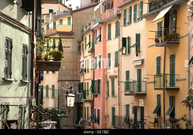 A view of multicolored buildings in Riomaggiore in the Cinque Terre, Italy. - Stock Image
