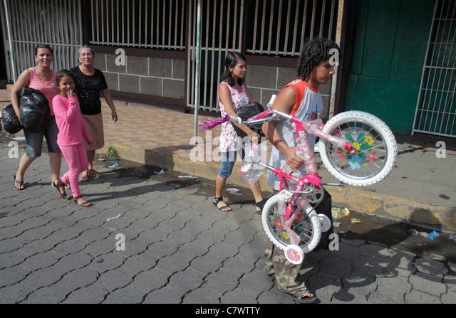 Managua Nicaragua Mercado Oriental flea market marketplace shopping purchase Hispanic woman girl boy teen grandmother - Stock Image