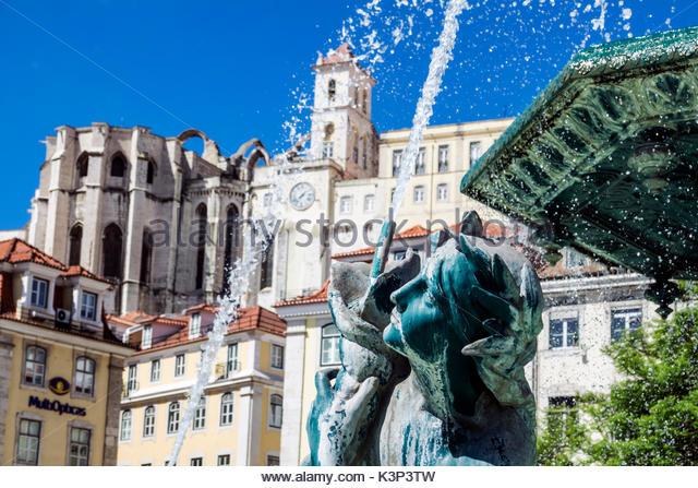 Lisbon Portugal Rossio Square Pedro IV Square fountain statue view Carmo ruins - Stock Image