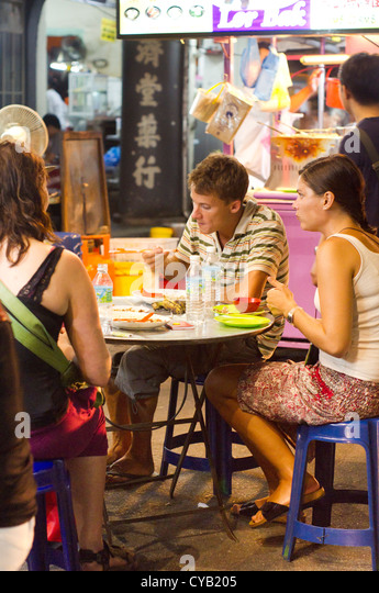 travelers and tourists are having street food in asia, photo is taken ...